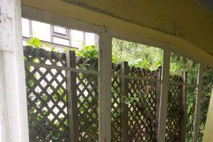 exterior painting on trellis